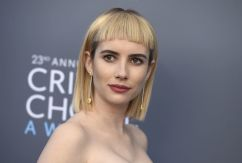 Emma Roberts arrives at the 23rd annual Critics' Choice Awards at the Barker Hangar on Thursday, Jan. 11, 2018, in Santa Monica, Calif.